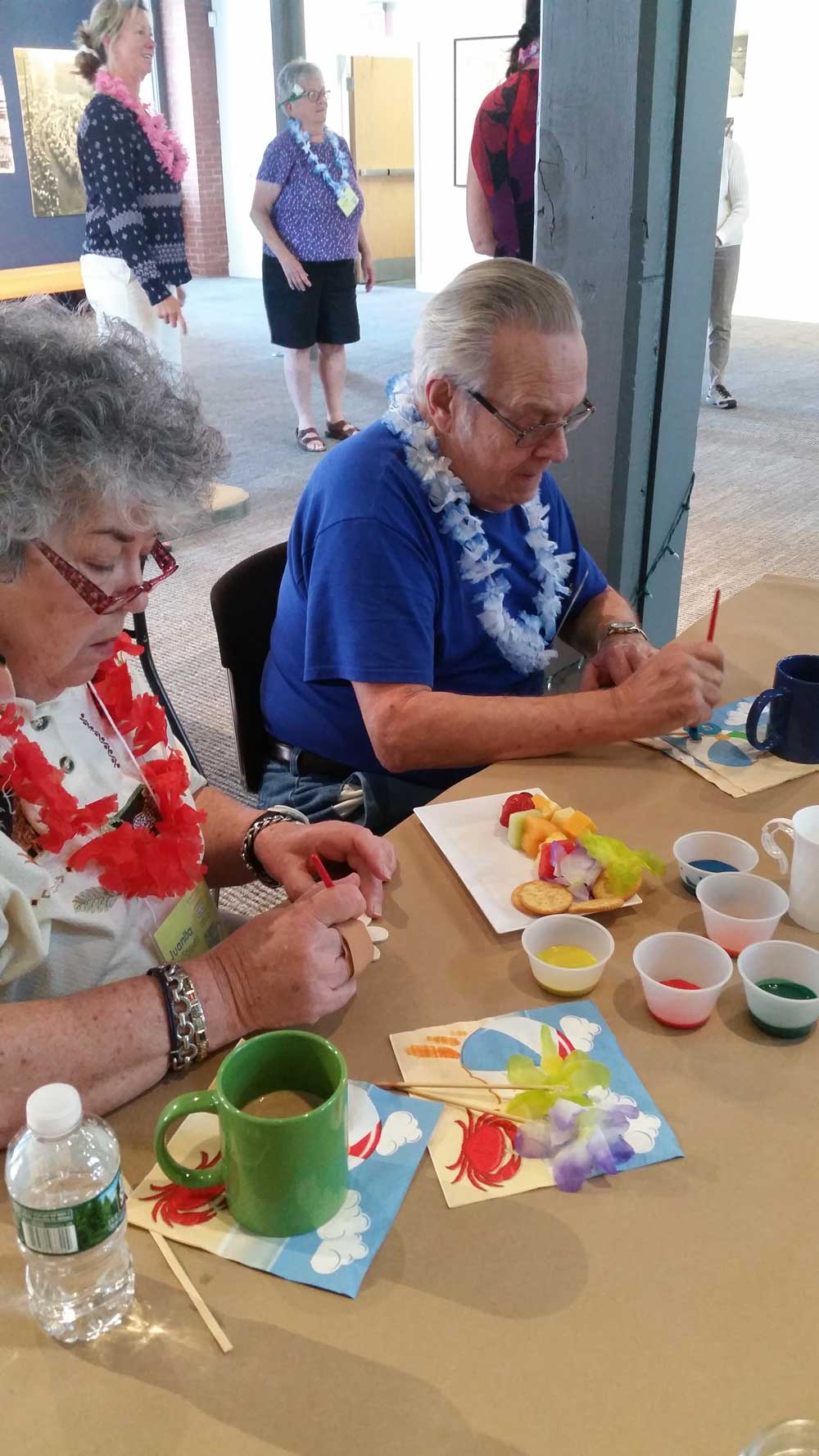 Older Man and Woman Making a Hawaiin Craft